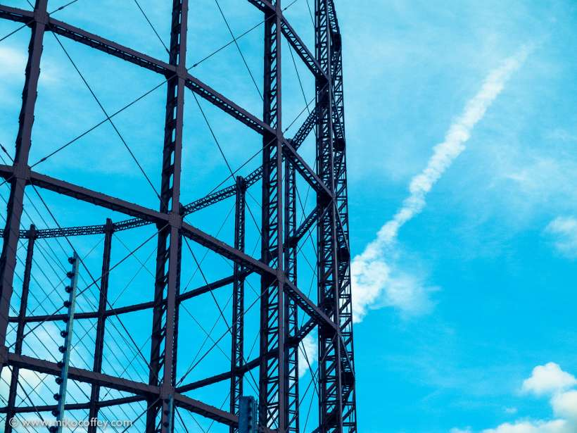 Gasometer with Contrail